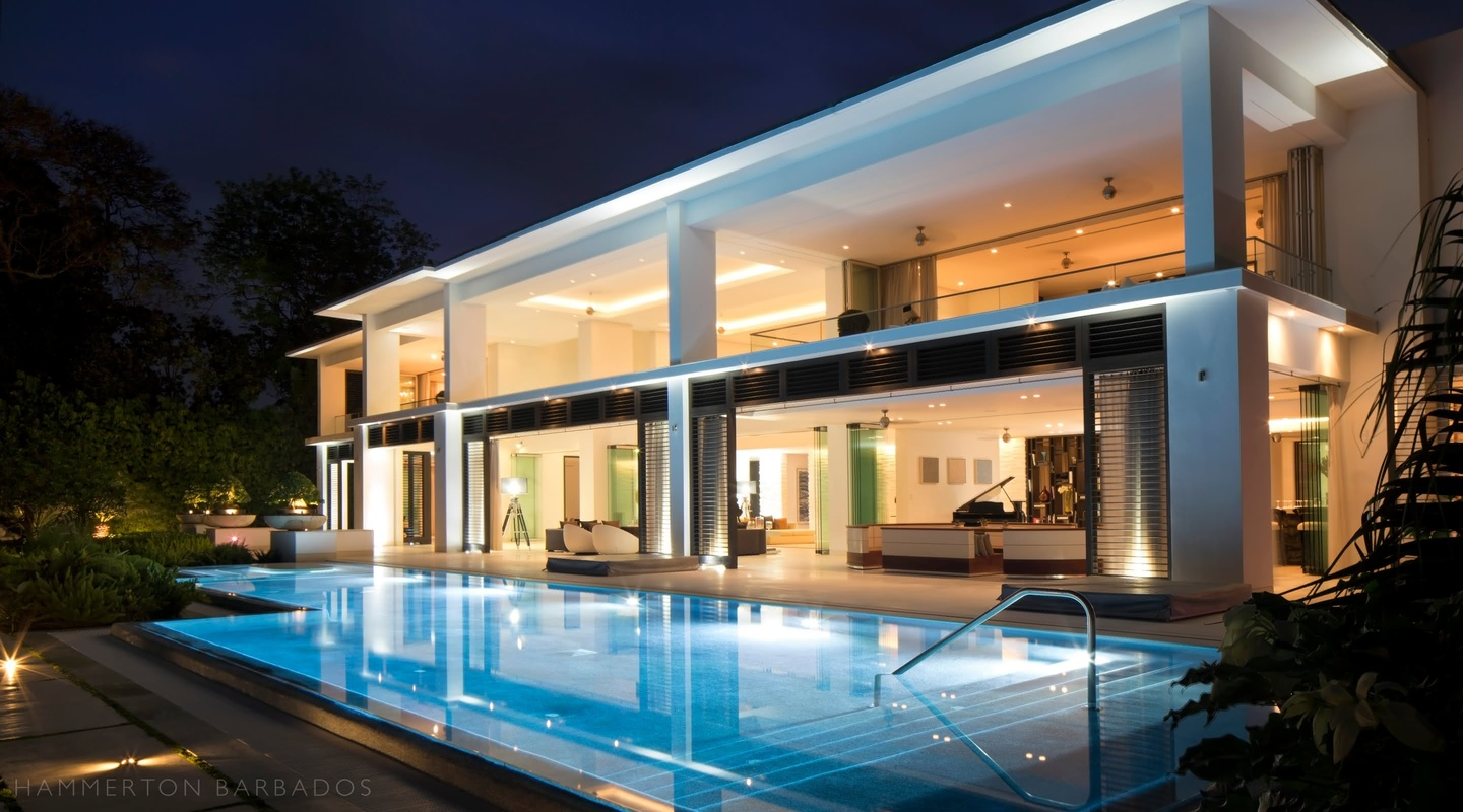 Alaya villa and swimming pool lit up at night