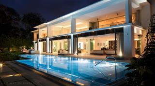 Alaya villa and swimming pool lit up at night
