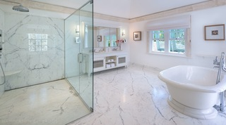 Kiko Villa luxurious modern marble bathroom with large glass shower and roll top bath tub