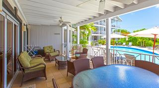 Lantana 2's veranda with seating and swimming pool view