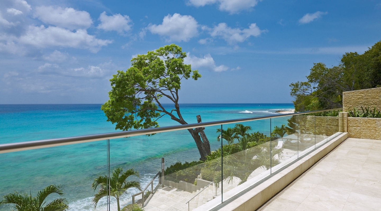 View from balcony of the Barbados ocean and tree
